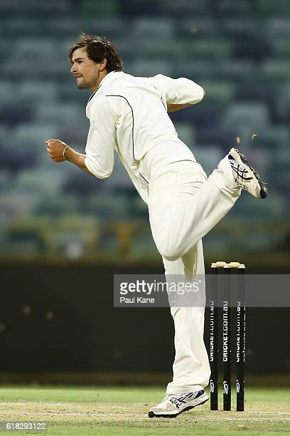 Ashton Agar of the Warriors bowls during day two of the Sheffield Shield match between Western Australia and South Australia at the WACA on October...