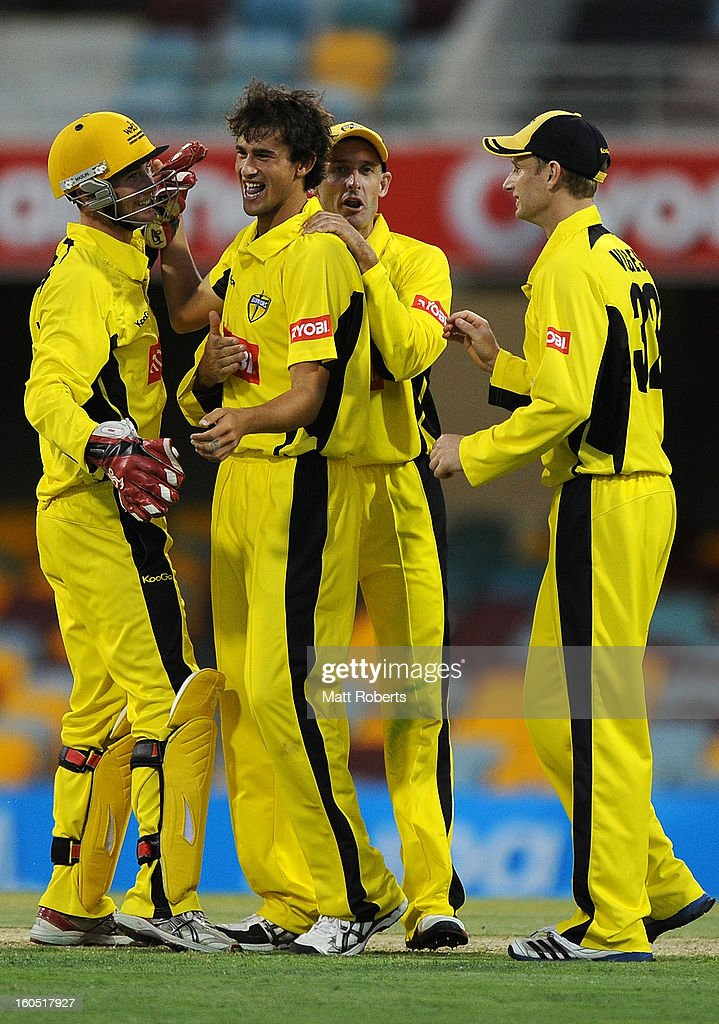 Ashton Agar (C) of the Warriors celebrates a wicket during the Ryobi One Day Cup match between the Queensland Bulls and the Western Australia Warriors at The Gabba on February 2, 2013 in Brisbane, Australia.