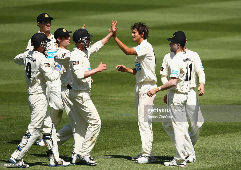 Ashton Agar of the Warriors celebrates taking the wicket of Rob Quiney of the Bushrangers during day three of the Sheffield Shield match between the Victoria Bushrangers and the Western Australia Warriors at Melbourne Cricket Ground on November 1, 2013 in Melbourne, Australia.