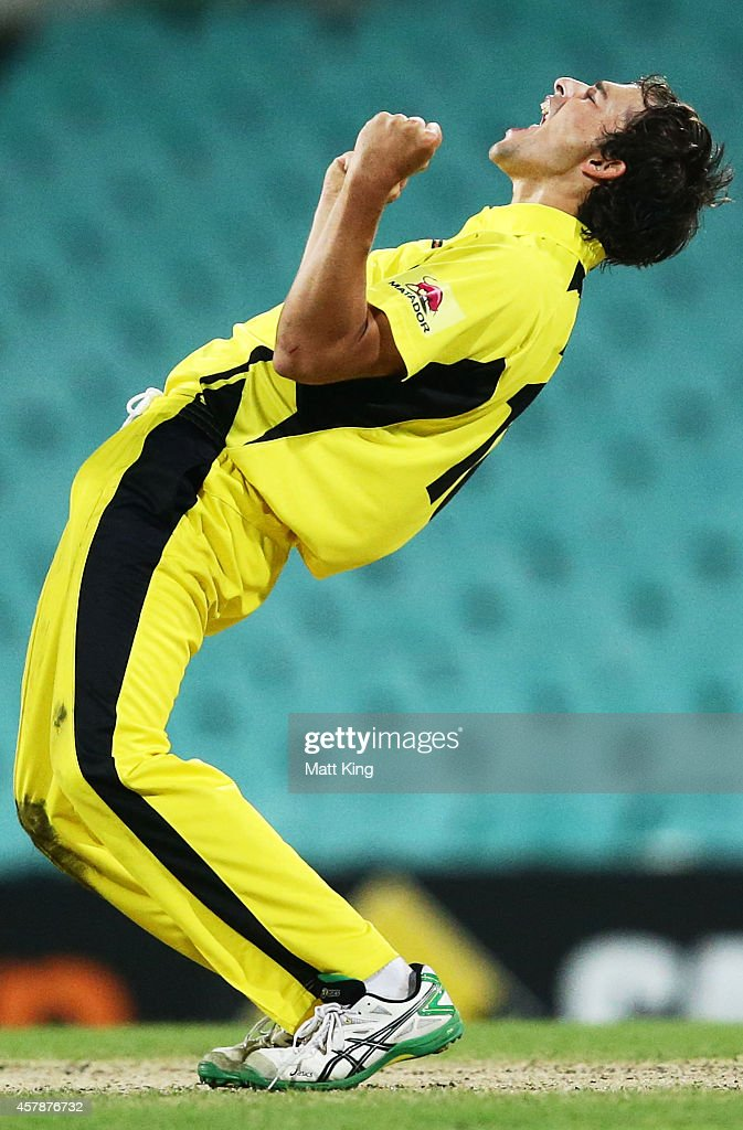 Ashton Agar of the Warriors celebrates taking the wicket of Shane Watson of the Blues during the Matador BBQs One Day Cup Final match between Western Australia and New South Wales at Sydney Cricket Ground on October 26, 2014 in Sydney, Australia.