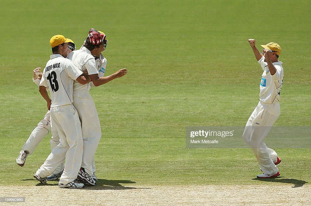 Ashton Agar of the Warriors celebrates with teammates after taking the wicket of Scott Henry of the Blues during day two of the Sheffield Shield match between the New South Wales Blues and the Western Australia Warriors at Blacktown International Sportspark on January 25, 2013 in Sydney, Australia.