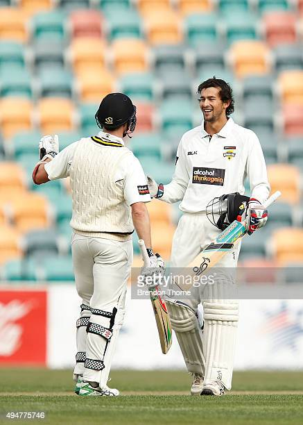 Ashton Agar of Western Australia celebrates with team mate Michael Klinger after scoring his century during day two of the Sheffield Shield match...