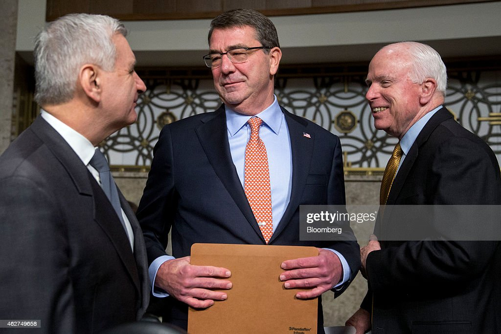 <a gi-track='captionPersonalityLinkClicked' href=/galleries/search?phrase=Ashton+Carter&family=editorial&specificpeople=956792 ng-click='$event.stopPropagation()'>Ashton Carter</a>, former deputy secretary of defense and U.S. President Barack Obama's nominee to be U.S. secretary of defense, center, arrives to a Senate Armed Services Committee nomination hearing with Senator <a gi-track='captionPersonalityLinkClicked' href=/galleries/search?phrase=John+McCain&family=editorial&specificpeople=125177 ng-click='$event.stopPropagation()'>John McCain</a>, a Republican from Arizona and chairman of the Senate Armed Services Committee, right, and Senator <a gi-track='captionPersonalityLinkClicked' href=/galleries/search?phrase=Jack+Reed+-+Politician&family=editorial&specificpeople=534274 ng-click='$event.stopPropagation()'>Jack Reed</a>, a Democrat from Rhode Island, in Washington, D.C., U.S., on Wednesday, Feb. 4, 2015. Carter pledged to stop cost overruns and other wasteful spending, even as he pleaded for relief from automatic budget cuts that will resume in October.