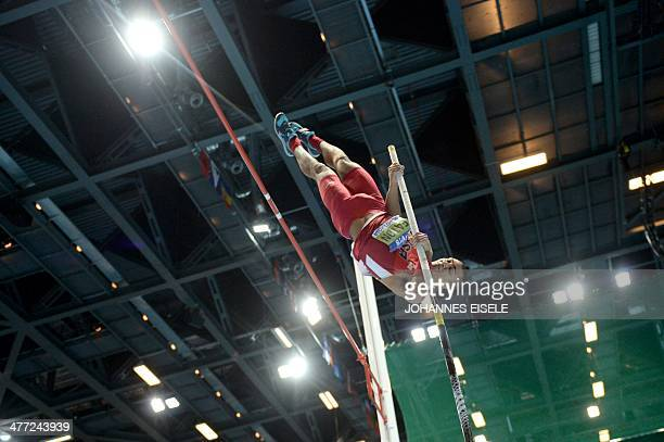US Ashton Eaton competes in the Men's Heptathlon Pole Vault group A at the IAAF World Indoor Athletics Championships in the Ergo Arena in the Polish...