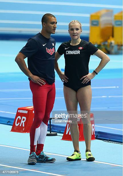 Ashton Eaton of the United States and Brianne Theisen Eaton of Canada talk during day one of the IAAF World Indoor Championships at Ergo Arena on...