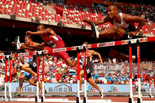Ashton Eaton of the United States and Damian Warner of Canada compete in the Men's Decathlon 110 metres hurdles during day eight of the 15th IAAF...