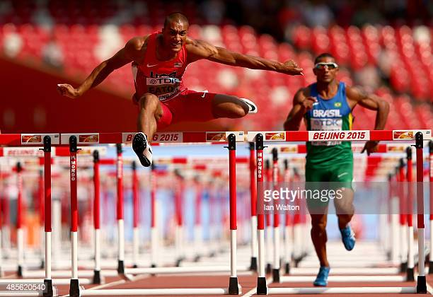 Ashton Eaton of the United States and Felipe Dos Santos of Brazil compete in the Men's Decathlon 110 metres hurdles during day eight of the 15th IAAF...