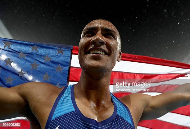Ashton Eaton of the United States celebrates winning gold overall after the Men's Decathlon 1500m on Day 13 of the Rio 2016 Olympic Games at the...