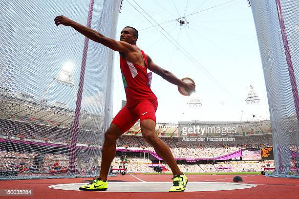 Ashton Eaton of the United States competes during the Men's Decathlon Discus Throw on Day 13 of the London 2012 Olympic Games at Olympic Stadium on...