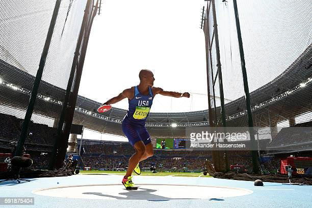 Ashton Eaton of the United States competes in the Men's Decathlon Discus Throw on Day 13 of the Rio 2016 Olympic Games at the Olympic Stadium on...