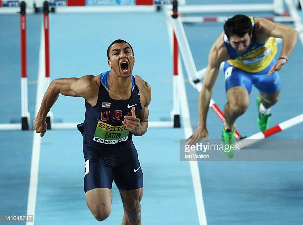 Ashton Eaton of the United States crosses the line as Oleksiy Kasynov of Ukraine stumbles in the Men's 60 Metres Hurdles in the Heptathlon during day...