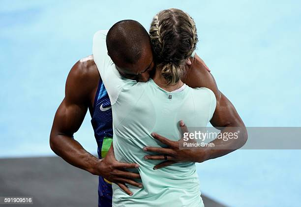 Ashton Eaton of the United States embraces wife Brianne TheisenEaton after the Men's Decathlon 1500m and winning gold overall on Day 13 of the Rio...