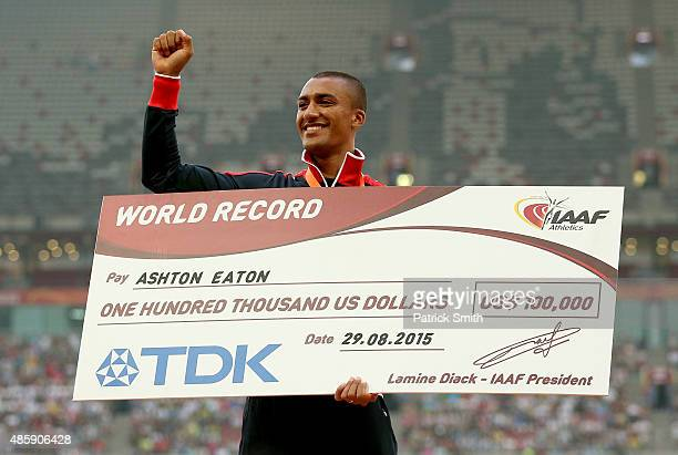 Ashton Eaton of the United States is presented with a cheque after breaking the World Record for Men's Decathlon with 9045 points during day nine of...