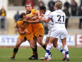 Ashton Hewitt of Newport Gwent Dragons reacts with Matt Everard of London Wasps during the LV= Cup match between Newport Gwent Dragons and London...