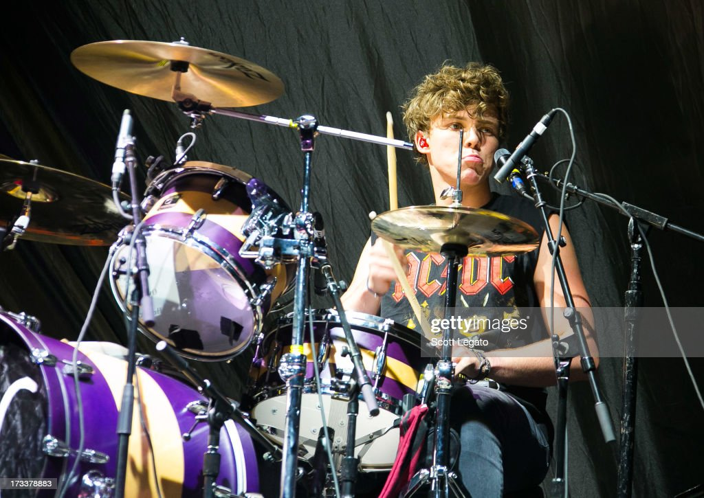 Ashton Irwin of 5 Seconds of Summer performs at The Palace of Auburn Hills on July 12, 2013 in Auburn Hills, Michigan.