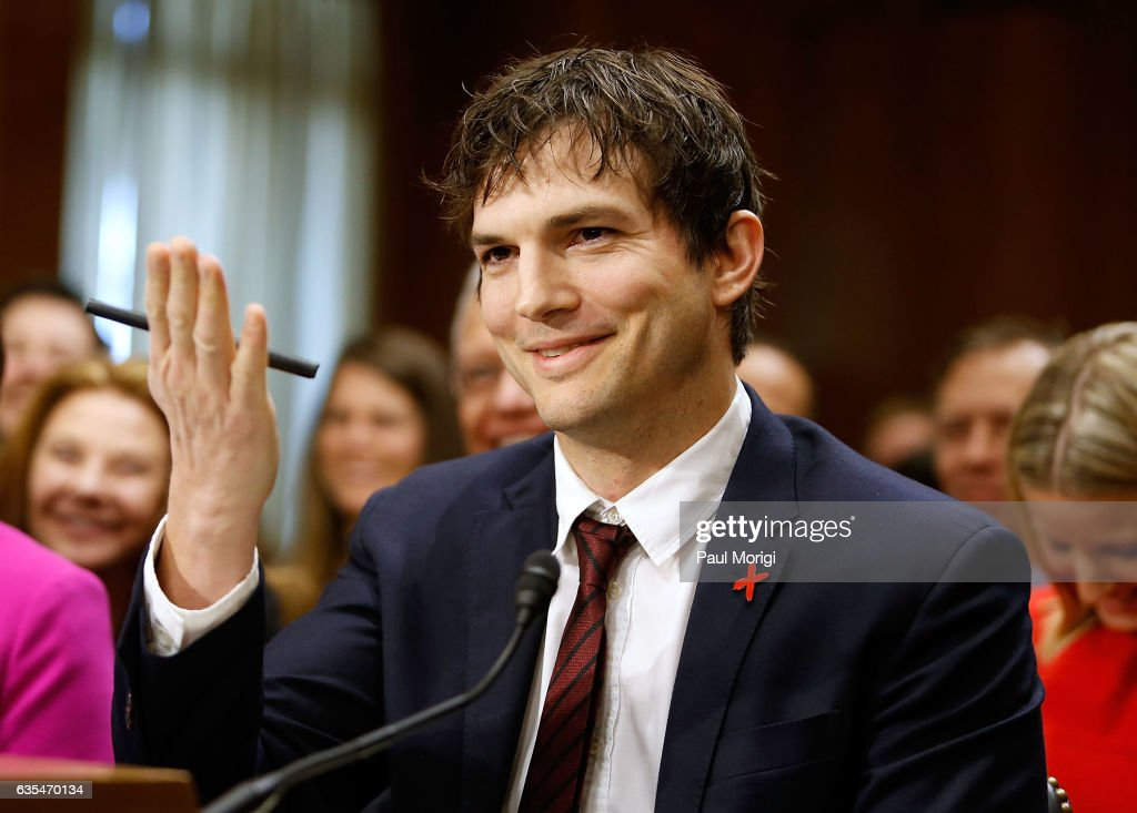 Ashton Kutcher, Actor and Co-Founder of Thorn: Digital Defenders of Children, blows Sen. John McCain a kiss after he commented on how Kutcher looks better in person than he does on film during a Senate Foreign Relations Committee hearing on Ending Modern Slavery: Building on Success at Dirksen Senate Office Building on February 15, 2017 in Washington, DC.