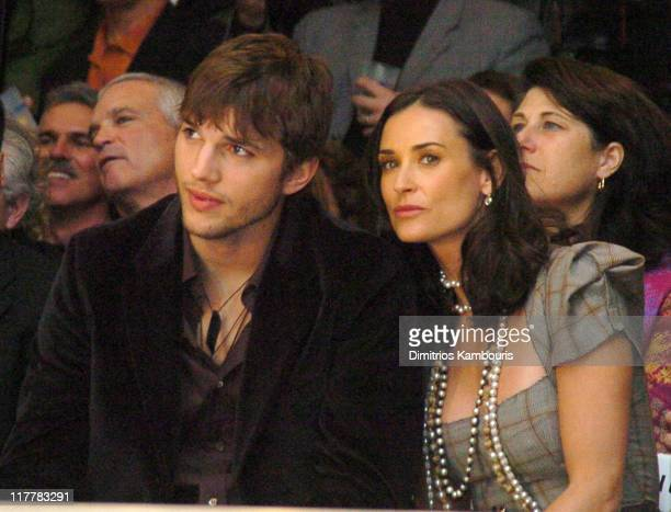 Ashton Kutcher and Demi Moore during 4th Annual 'ten' Fashion Show Presented By General Motors Backstage and Audience in Los Angeles California...