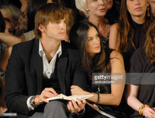 Ashton Kutcher and Demi Moore during Olympus Fashion Week Spring 2007 Marc Jacobs Inside at New York State Armory in New York City New York United...