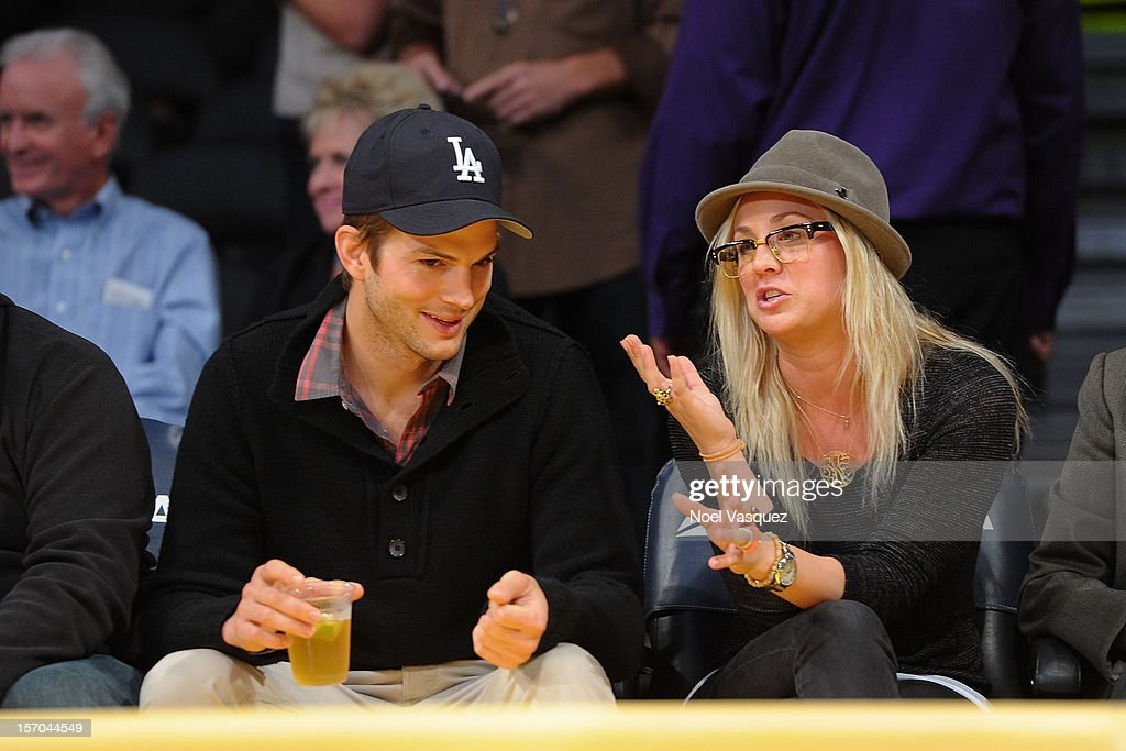 Ashton Kutcher (L) and Kaley Cuoco attend a basketball game between the Indiana Pacers and the Los Angeles Lakers at Staples Center on November 27, 2012 in Los Angeles, California.