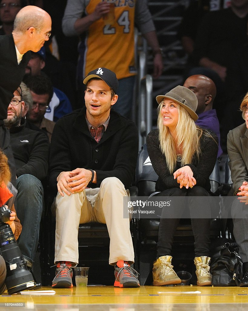 <a gi-track='captionPersonalityLinkClicked' href=/galleries/search?phrase=Ashton+Kutcher&family=editorial&specificpeople=202015 ng-click='$event.stopPropagation()'>Ashton Kutcher</a> (L) and <a gi-track='captionPersonalityLinkClicked' href=/galleries/search?phrase=Kaley+Cuoco&family=editorial&specificpeople=208988 ng-click='$event.stopPropagation()'>Kaley Cuoco</a> attend a basketball game between the Indiana Pacers and the Los Angeles Lakers at Staples Center on November 27, 2012 in Los Angeles, California.