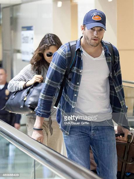 Ashton Kutcher and Mila Kunis are seen at Los Angeles Interntational airport on April 19 2014 in Los Angeles California