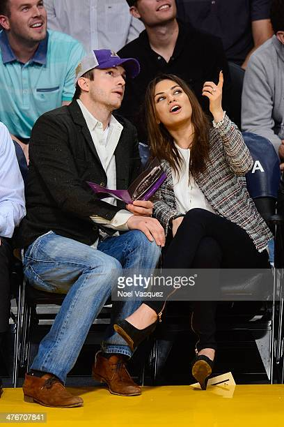 Ashton Kutcher and Mila Kunis attend a basketball game between the New Orleans Pelicans and the Los Angeles Lakers at Staples Center on March 4 2014...