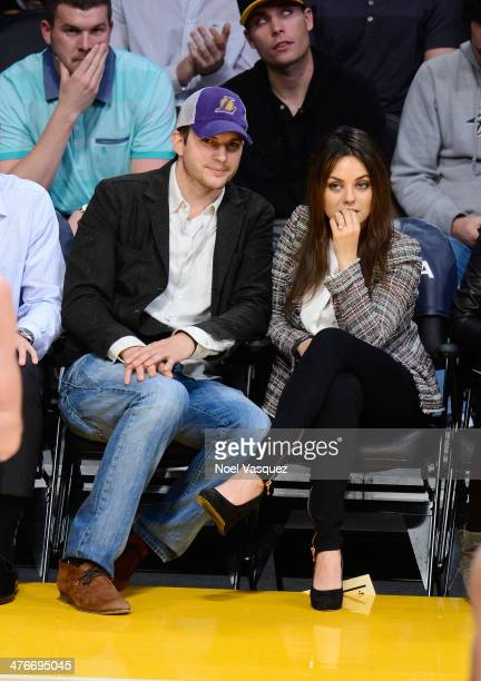 Ashton Kutcher and Mila Kunis attend basketball games between the New Orleans Pelicans and the Los Angeles Lakers at Staples Center on March 4 2014...