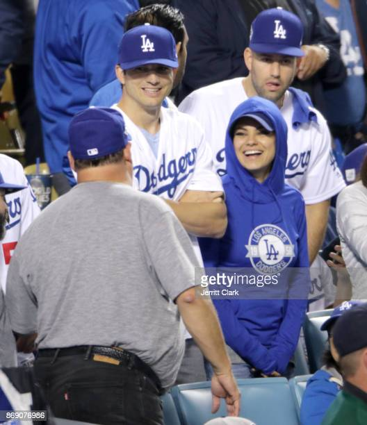 Ashton Kutcher and Mila Kunis attend game six of the 2017 World Series at Dodger Stadium on October 31 2017 in Los Angeles California