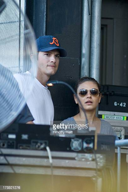 Ashton Kutcher and Mila Kunis watch from the stage as Robin Thicke performs during the 2013 Taste Of Chicago at Grant Park on July 11 2013 in Chicago...