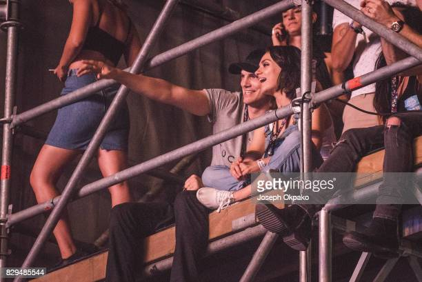 Ashton Kutcher and Mila Kunis watch Wiz Khalifa's set during Day 2 of Sziget Festival 2017 on August 10 2017 in Budapest Hungary