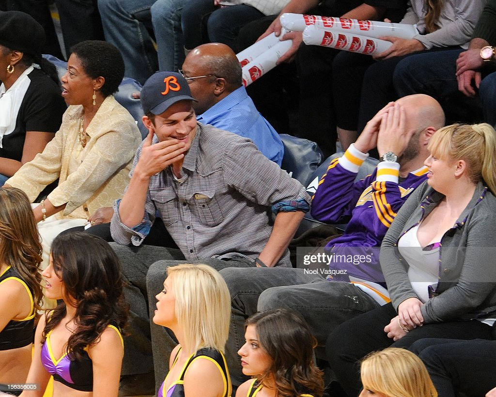 Ashton Kutcher and Rebel Wilson attend a basketball game between the San Antonio Spurs and the Los Angeles Lakers at Staples Center on November 13, 2012 in Los Angeles, California.