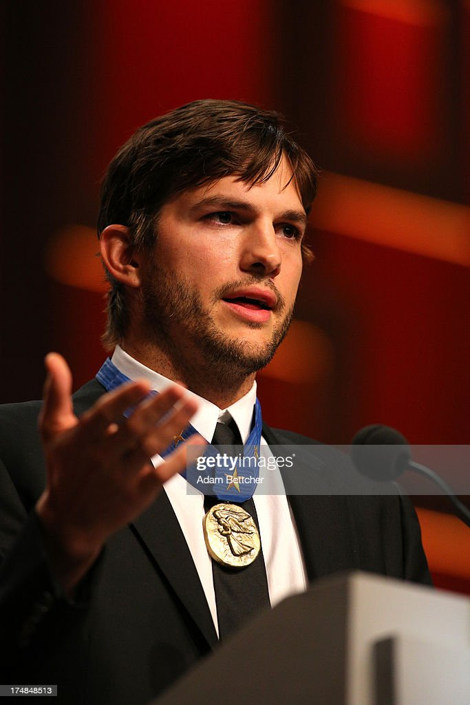 Ashton Kutcher presents at the 2013 Starkey Hearing Foundation's 'So the World May Hear' Awards Gala on July 28, 2013 in St. Paul, Minnesota.
