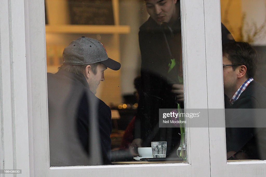<a gi-track='captionPersonalityLinkClicked' href=/galleries/search?phrase=Ashton+Kutcher&family=editorial&specificpeople=202015 ng-click='$event.stopPropagation()'>Ashton Kutcher</a> seen at a cafe in Soho on April 12, 2013 in London, England.