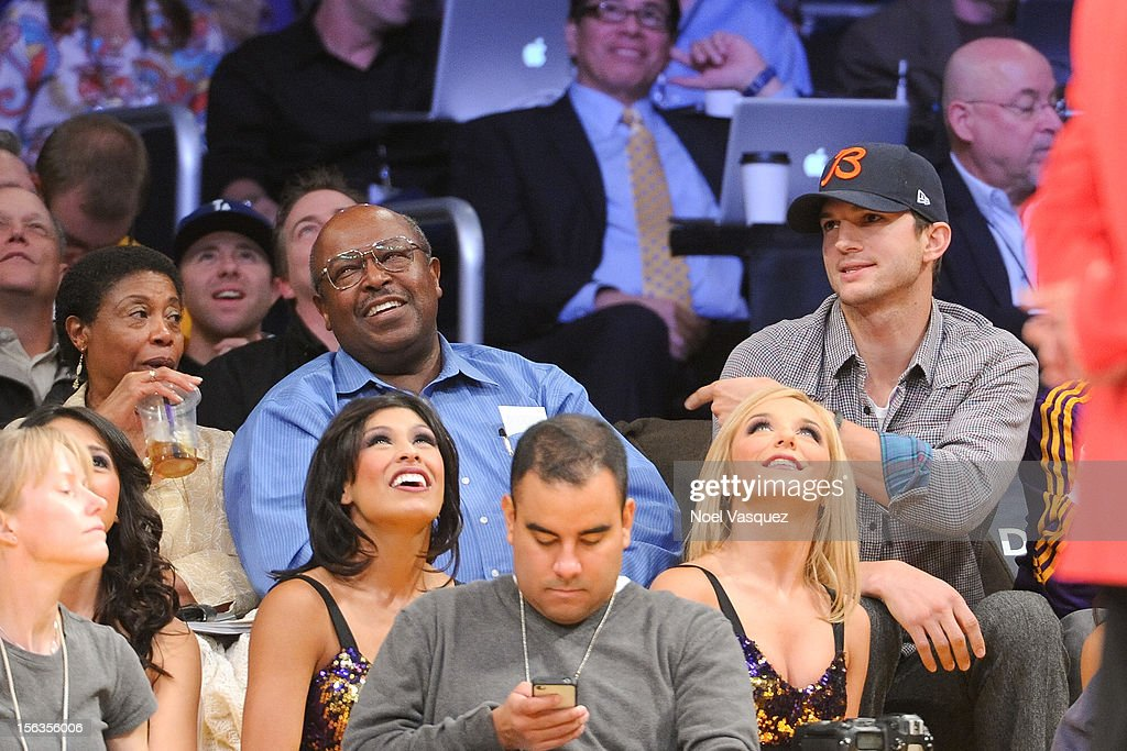 Ashton Kutcher (R) sets up guest (L) to be placed on 'Kiss Cam' at a basketball game between the San Antonio Spurs and the Los Angeles Lakers at Staples Center on November 13, 2012 in Los Angeles, California.
