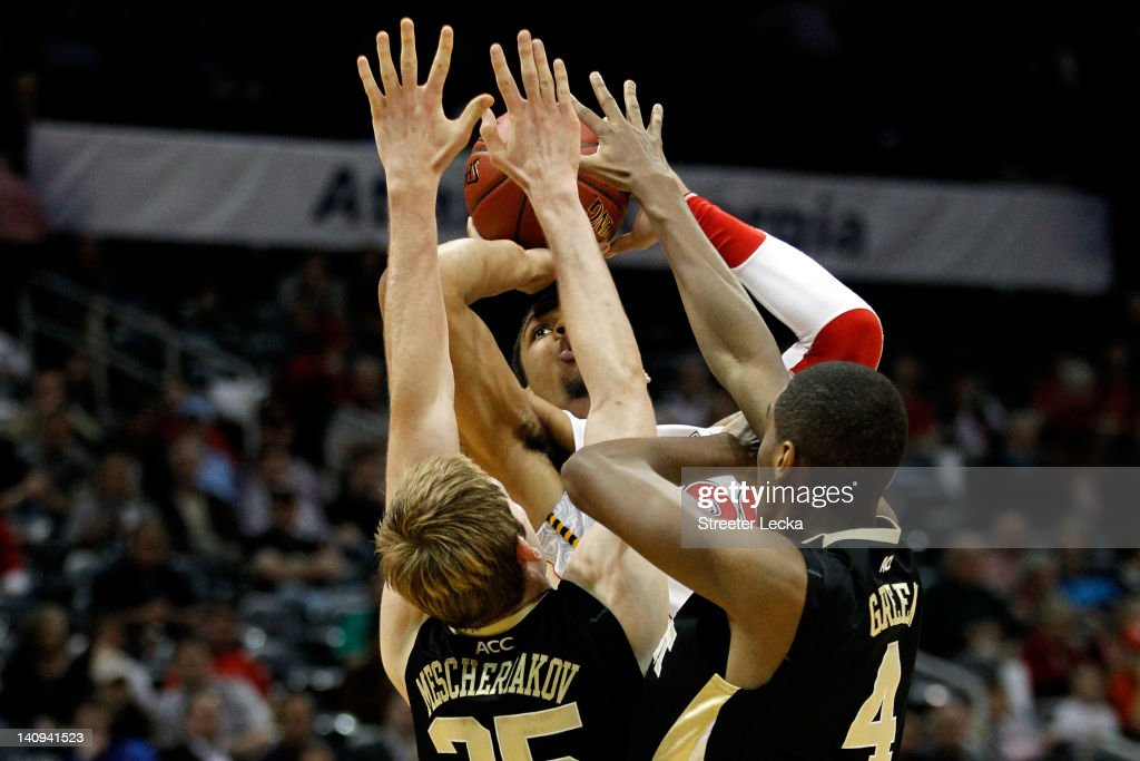 Ashton Pankey #30 of the Maryland Terrapins attempts a shot in the second half against Nikita Mescheriakov #25 and Daniel Green #4 of the Wake Forest Demon Deacons during their first round game of 2012 ACC Men's Basketball Conferene Tournament at Philips Arena on March 8, 2012 in Atlanta, Georgia.