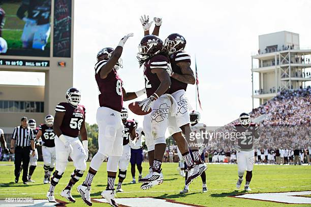 Ashton Shumpert of the Mississippi State Bulldogs celebrates with teammates after scoring a touchdown during a game against the Northwestern State...