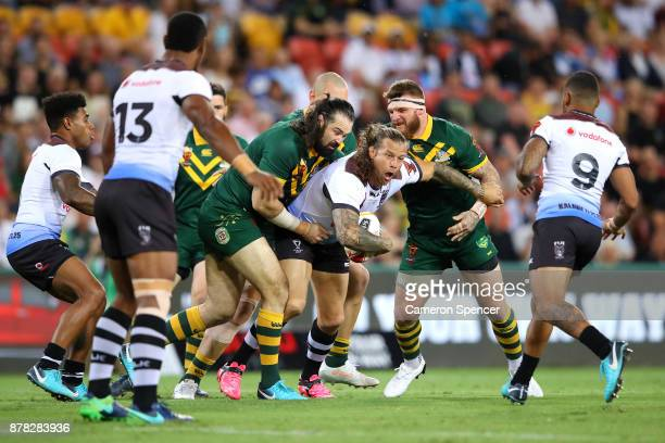 Ashton Sims of Fiji is tackled during the 2017 Rugby League World Cup Semi Final match between the Australian Kangaroos and Fiji at Suncorp Stadium...