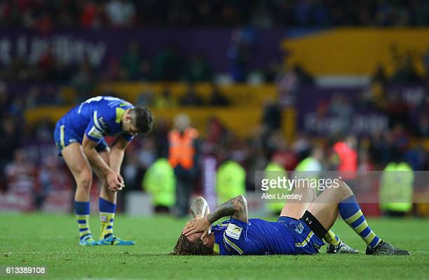Ashton Sims of Warrington Wolves look dejected after defeat to Wigan Warriors in the First Utility Super League Final between Warrington Wolves and...