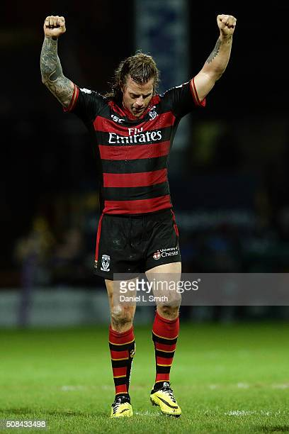 Ashton Sims of Warrington Wolves raises his hands in celebration of Warrington Wolves winning the First Utility Super League opening match between...