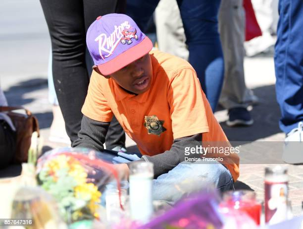 Ashton Smith of Las Vegas Nevada attends a memorial on Las Vegas Boulevard and Reno Avenue for the victims of the Route 91 Harvest country music...