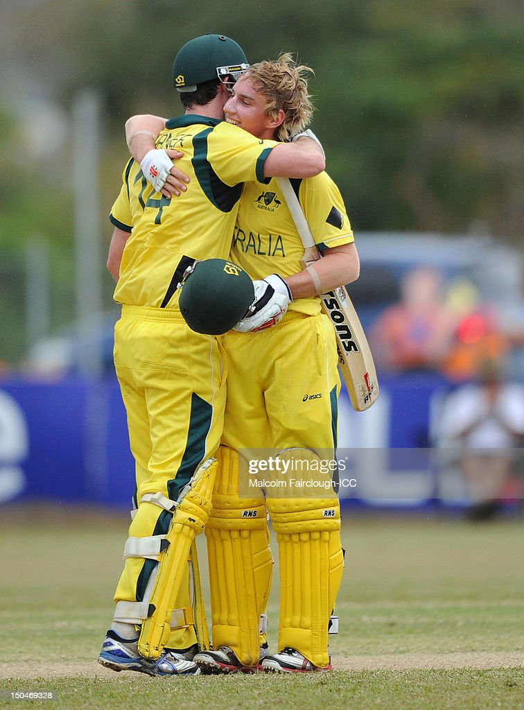 Ashton Turner and William Bosisto embrace on the ground after guiding Australia to a win during the ICC U19 Cricket World Cup 2012 Quarter Final match between Australia and Bangladesh at Endeavour Park on August 19, 2012 in Townsville, Australia.