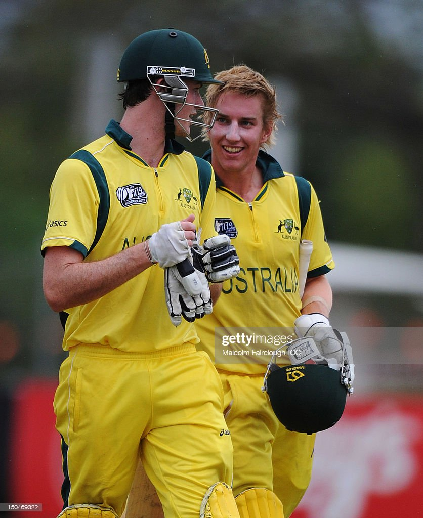 Ashton Turner and William Bosisto leave the ground after guiding Australia to a win during the ICC U19 Cricket World Cup 2012 Quarter Final match between Australia and Bangladesh at Endeavour Park on August 19, 2012 in Townsville, Australia.