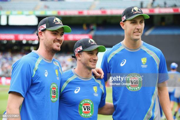 Ashton Turner Michael Klinger and Billy Stanlake of Australia of Australia pose before playing their first game during the first International...