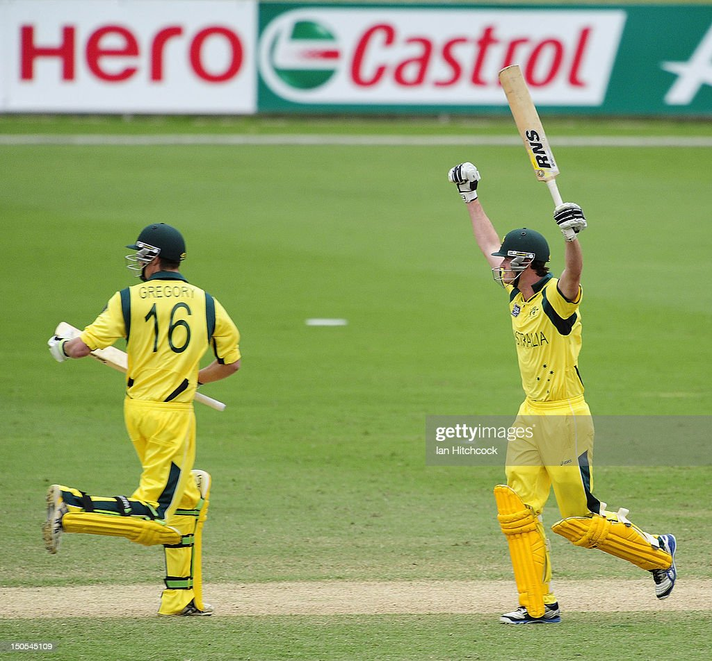 Ashton Turner (r) of Australia celebrates after hitting the winning runs during the ICC U19 Cricket World Cup 2012 Semi Final match between Australia and South Africa at Tony Ireland Stadium on August 21, 2012 in Townsville, Australia.