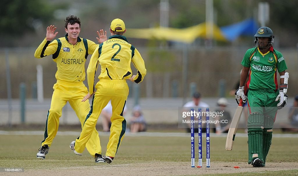 Ashton Turner (L) of Australia celebrates the runout of Litton Kumar Das from a direct hit on the stumps by Cameron Bancroft (R) during the ICC U19 Cricket World Cup 2012 Quarter Final match between Australia and Bangladesh at Endeavour Park on August 19, 2012 in Townsville, Australia.