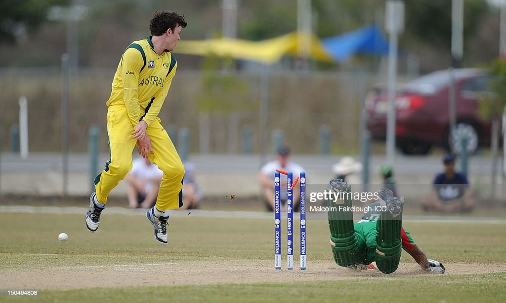 Ashton Turner of Australia leaping into the air as Litton Kumar Das is runout from a direct hit on the stumps by Cameron Bancroft during the ICC U19 Cricket World Cup 2012 Quarter Final match between Australia and Bangladesh at Endeavour Park on August 19, 2012 in Townsville, Australia.
