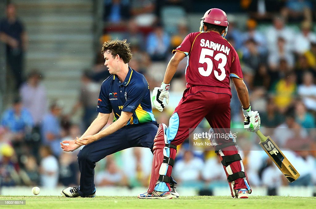 Ashton Turner of the PM's XI drops a catch off his own bowling during the International Tour Match between the Prime Minister's XI and West Indies at Manuka Oval on January 29, 2013 in Canberra, Australia.