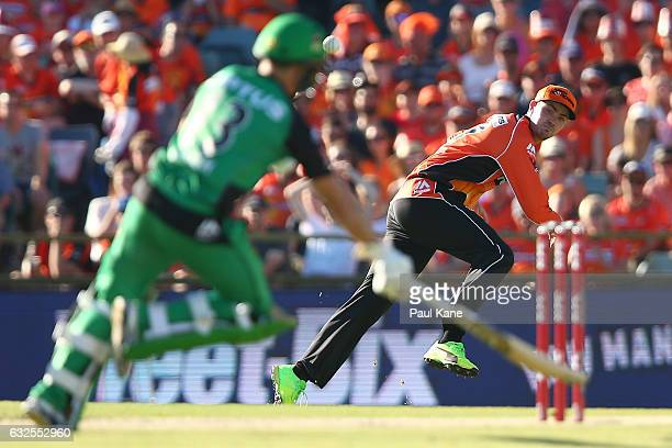 Ashton Turner of the Scorchers attempts to run out Seb Gotch of the Stars during the Big Bash League match between the Perth Scorchers and the...