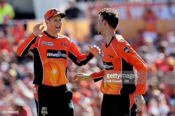 Ashton Turner of the Scorchers celebrates after taking the wicket of Daniel Hughes of the Sixers during the Big Bash League match between the Perth...