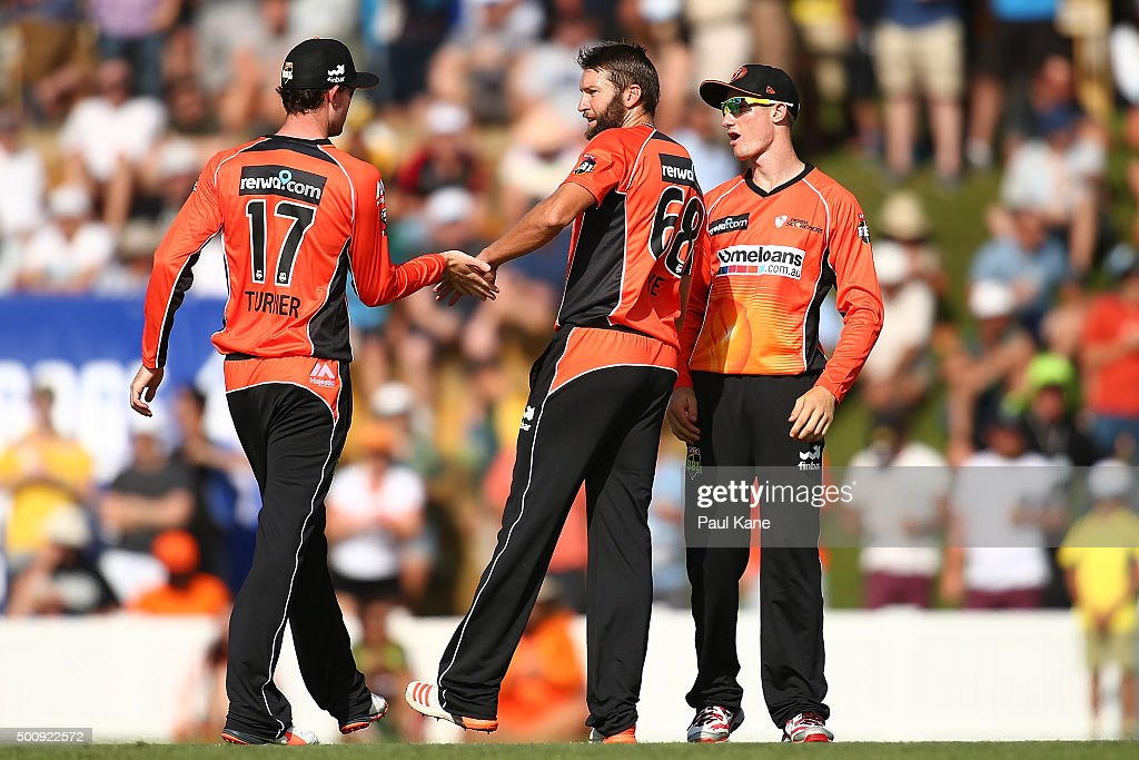 Ashton Turner of the Scorchers congratulates Andrew Tye after dismissing Ricky Ponting of the Legends during the WA Festival of Cricket Legends Match between the Australian Legends XI and Perth Scorchers at Aquinas College on December 11, 2015 in Perth, Australia.
